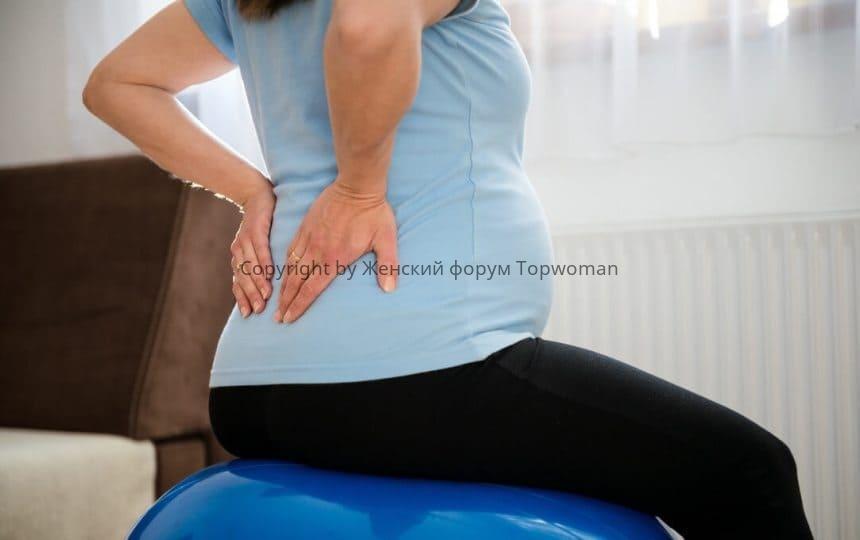 Почему ноет поясница при беременности